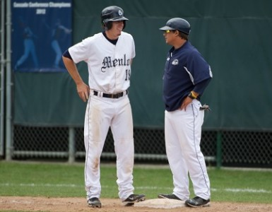 John Bowling (left) chats with Asst. Coach David Tufo during a 2013 game.